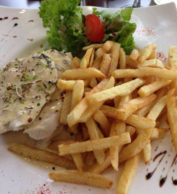 Main course... Chicken in a fennel and citron creme sauce and frites.