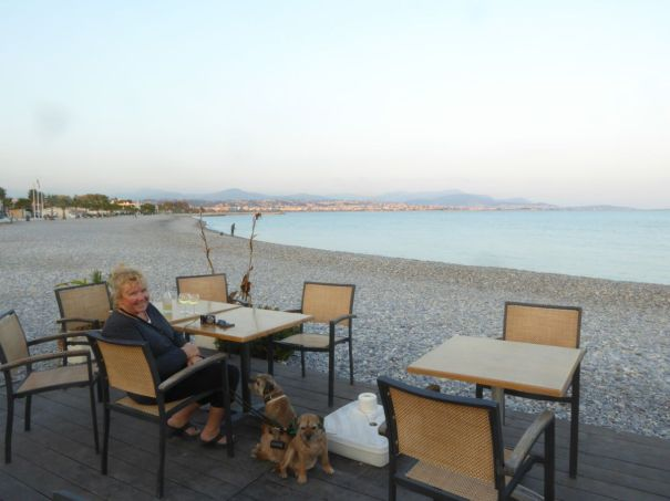Cafe on the beach at Villeneuve-Loubet, Nice is on the far horizon.