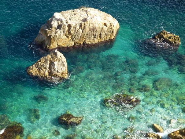 Clear Green Water at the foot of the cliffs.
